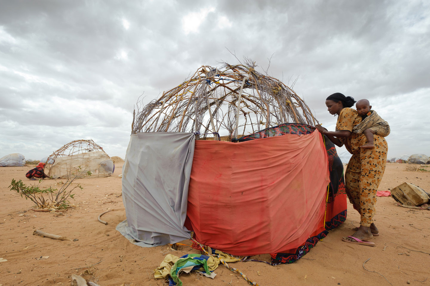 Reaching Dadaab, Isnino was exhausted but had to make her own hut out of sticks, borrowed clothing scraps, and burlap sacks that once contained relief food.
