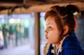 Leuk Daek's children learn from Savoeun's story.