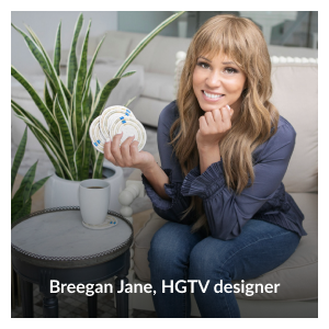 """Photo of Breegan Jane holding her """"Circle of Strength"""" upcycled papyrus grass coasters by Breegan Jane"""