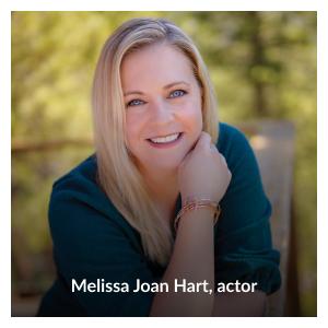 "Headshot of Melissa Joan Hart wearing her ""These Three Remain"" rose-gold toned bracelet by Melissa Joan Hart"