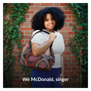 """Photo of Wé McDonald wearing her """"Bonded Together"""" faux suede and cotton embroidered tote by Wé McDonald"""