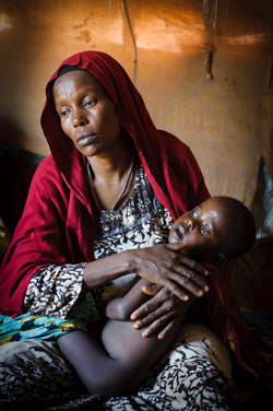 Gaalo cradles her son, Khaleed, praying that he won't die next. She has lost two children this month.